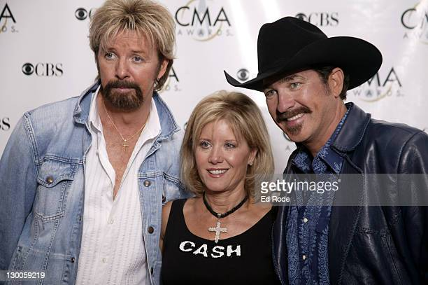 Ronnie Dunn his wife Janine and Kix Brooks during 37th Annual CMA Awards Arrivals at The Grand Ole Opry in Nashville TN United States