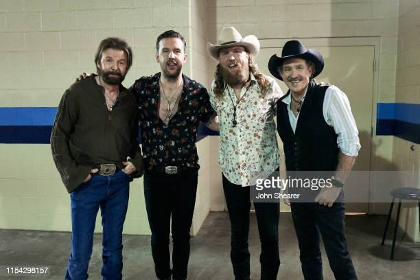 Ronnie Dunn of Brooks and Dunn TJ Osborne and John Osborne of Brothers Osborne and Kix Brooks of Brooks and Dunn attend day 1 of 2019 CMA Music...