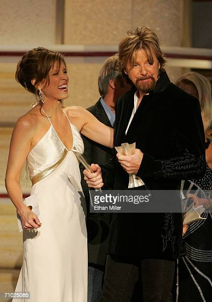 Ronnie Dunn of the band Brooks Dunn accepts the award for Song of the Year from television personality Hannah Storm onstage during the 41st Annual...