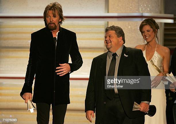Ronnie Dunn of the band Brooks Dunn and producer Craig Wiseman accepts the award for Song of the Year from television personality Hannah Storm...
