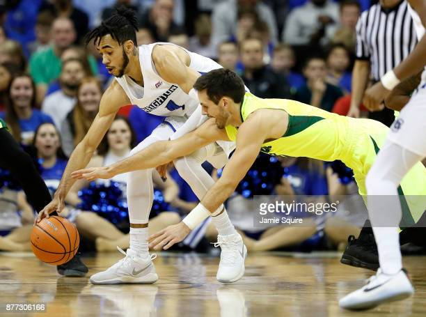 Ronnie Harrell Jr #4 of the Creighton Bluejays and Jake Lindsey of the Baylor Bears dive for a loose ball during the National Collegiate Basketball...