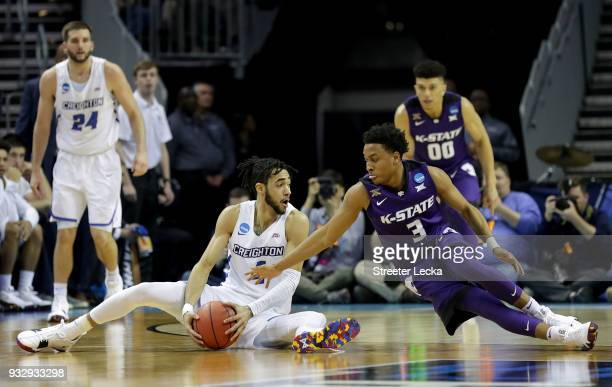 Ronnie Harrell Jr #4 of the Creighton Bluejays and Kamau Stokes of the Kansas State Wildcats compete for possession during the first round of the...
