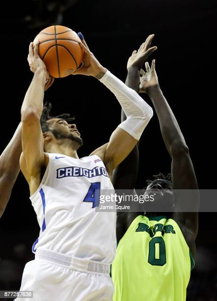 Ronnie Harrell Jr #4 of the Creighton Bluejays shoots over Jo LualAcuil Jr #0 of the Baylor Bears during the National Collegiate Basketball Hall Of...
