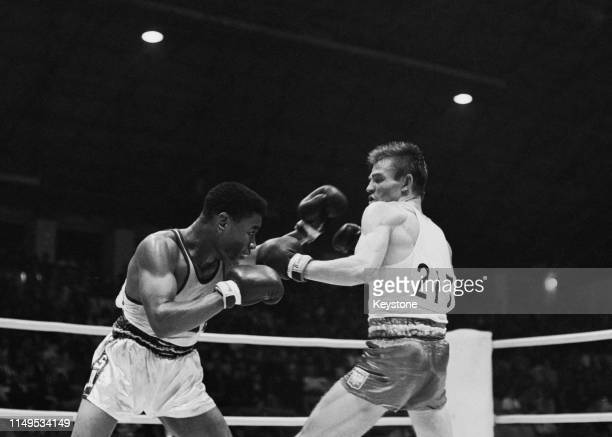 Ronnie Harris of the United States in action against Jazef Grudziea of Poland during their Men's Lightweight Semi-Finals Boxing bout on 21st October...