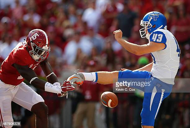 Ronnie Harrison of the Alabama Crimson Tide blocks a punt by Trevor Owens of the Middle Tennessee Blue Raiders at BryantDenny Stadium on September 12...