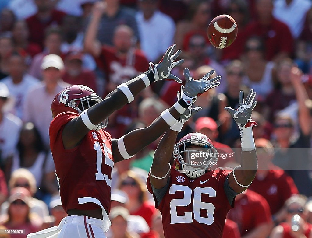 Ronnie Harrison #15 of the Alabama Crimson Tide intercepts a pass by the Western Kentucky Hilltoppers at Bryant-Denny Stadium on September 10, 2016 in Tuscaloosa, Alabama.
