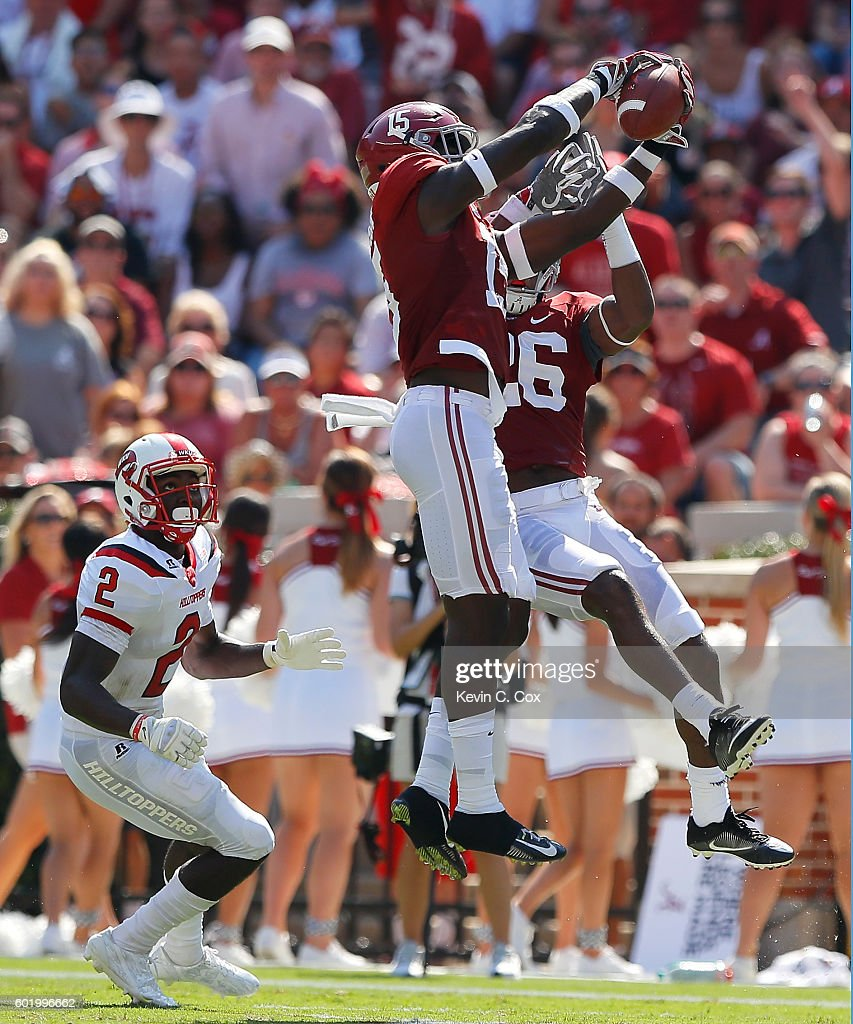 Ronnie Harrison #15 of the Alabama Crimson Tide intercepts a pass intended for Taywan Taylor #2 of the Western Kentucky Hilltoppers at Bryant-Denny Stadium on September 10, 2016 in Tuscaloosa, Alabama.