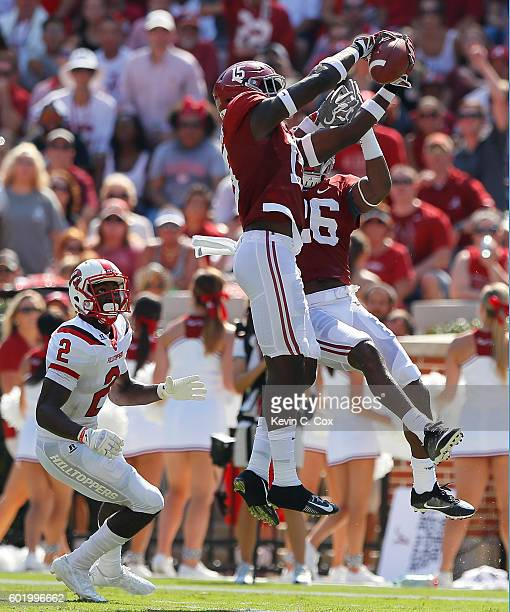 Ronnie Harrison of the Alabama Crimson Tide intercepts a pass intended for Taywan Taylor of the Western Kentucky Hilltoppers at BryantDenny Stadium...
