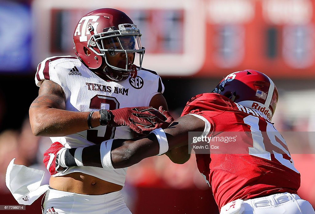 Ronnie Harrison #15 of the Alabama Crimson Tide tackles Christian Kirk #3 of the Texas A&M Aggies at Bryant-Denny Stadium on October 22, 2016 in Tuscaloosa, Alabama.
