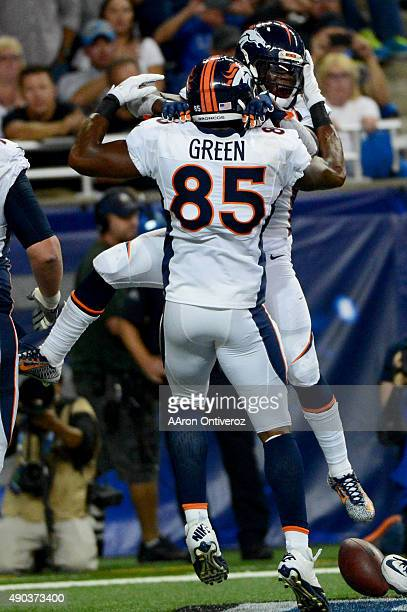 Ronnie Hillman of the Denver Broncos celebreats his 70 touchdown run with teammate Virgil Green against the Detroit Lions during the first half of...