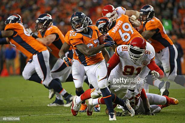 Ronnie Hillman of the Denver Broncos eludes Tamba Hali of the Kansas City Chiefs as he carries the ball at Sports Authority Field at Mile High on...