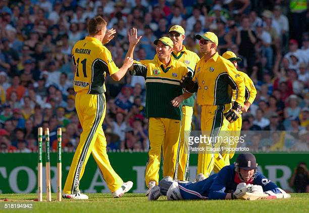 Ronnie Irani of England is run out by Glenn McGrath of Australia during the 2nd VB Series One Day International at Melbourne Australia 15th December...
