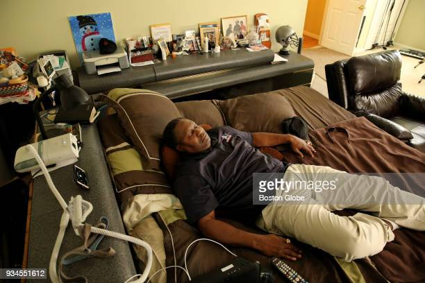 Ronnie Lippett listens to the bible in his room at his home in South Easton MA on March 14 2018 He said he probably spends 95% of his time in his...