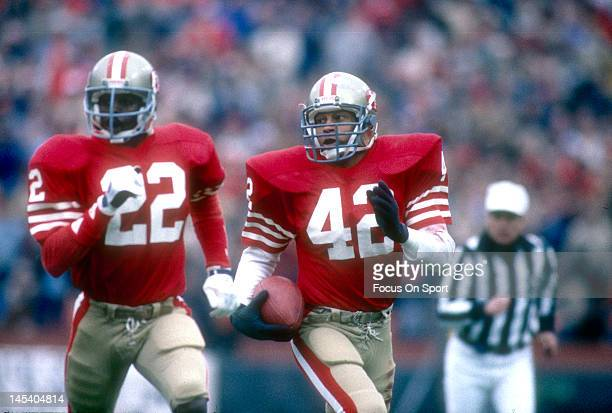 4ab74a53087 Ronnie Lott of the San Francisco 49ers returns an interception escorted by  teammate Dwight hicks during