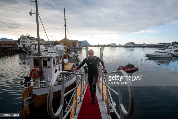 Ronnie Maas Pedersen is coming out of the water at The Arctic Triple // Lofoten Triathlon Extreme distance on August 19 2017 in Svolvar Norway...