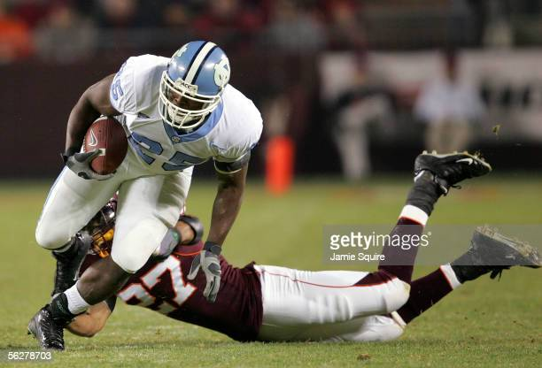 Ronnie McGill of the North Carolina Tar Heels carries the ball against Justin Hamilton of the Virginia Tech Hokies during the first half of the game...