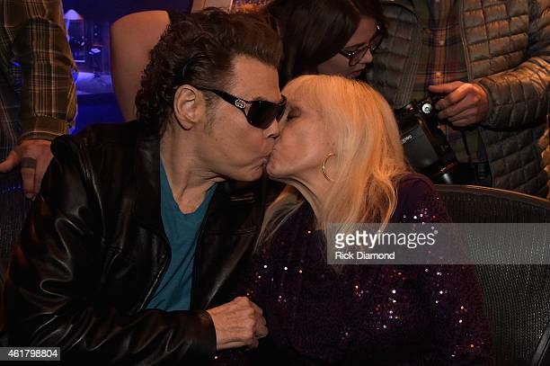 Ronnie Milsap and Joyce Milsap celebrate at Ronnie's Place Black River Entertainment on January 16 2015 in Nashville Tennessee