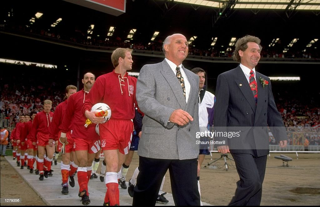 Ronnie Moran of Liverpool and Malcom Crosby of Sunderland lead their teams out before the FA Cup final at Wembley Stadium in London. Liverpool won the match 2-0. \ Mandatory Credit: Shaun Botterill/Allsport