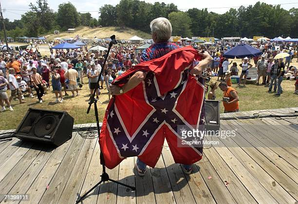 Ronnie Mullis dressed in a confederate flag overcoat performs during the 11th annual Summer Redneck Games July 8 2006 in Dublin Georgia Started in...
