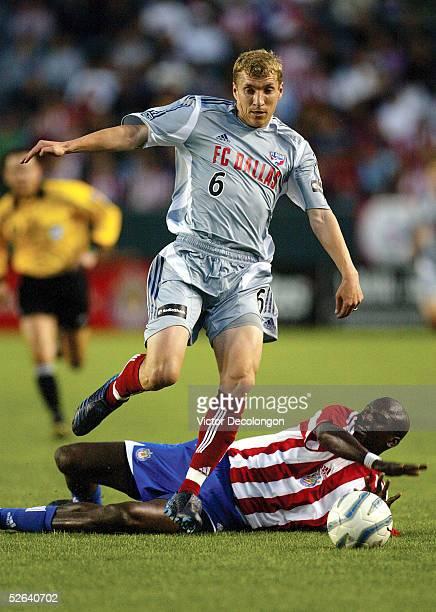 Ronnie O'Brien of FC Dallas eludes the tackle of Ezra Hendrickson of Chivas USA on April 16, 2005 at the Home Depot Center in Carson, California. FC...