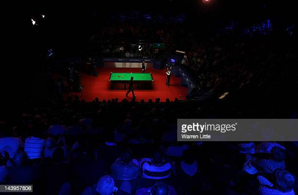 Ronnie O'Sullivan and Allister Carter of England in action during the final of the Betfredcom World Snooker Championship at the Crucible Theatre on...