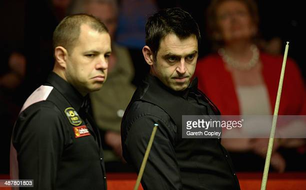Ronnie O'Sullivan and Barry Hawkins during their semi final in The Dafabet World Snooker Championship at Crucible Theatre on May 2 2014 in Sheffield...