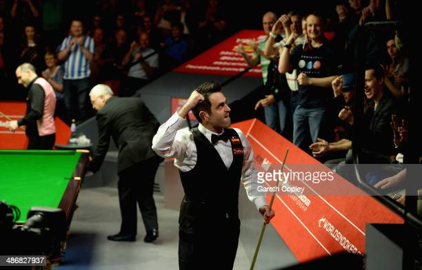 Ronnie O'Sullivan celebrates beating Joe Perry during their second round match in The Dafabet World Snooker Championship at Crucible Theatre on April...
