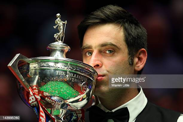 Ronnie O'Sullivan kisses the trophy after beating Allister Carter of England in the final of the Betfred.com World Snooker Championship at the...