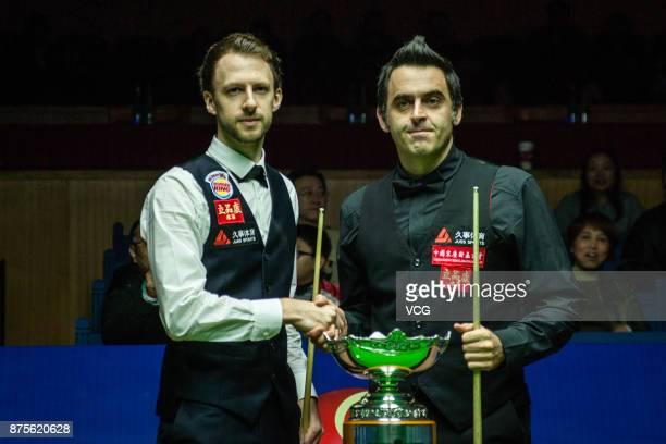 Ronnie O'Sullivan of England and Judd Trump of England shake hands during the final match on day six of 2017 Shanghai Masters at Shanghai Grand Stage...
