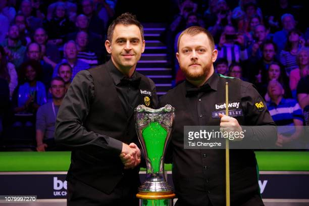 Ronnie O'Sullivan of England and Mark Allen of Northern Ireland pose for a photo during the final match on day 13 of 2018 Betway UK Championship at...