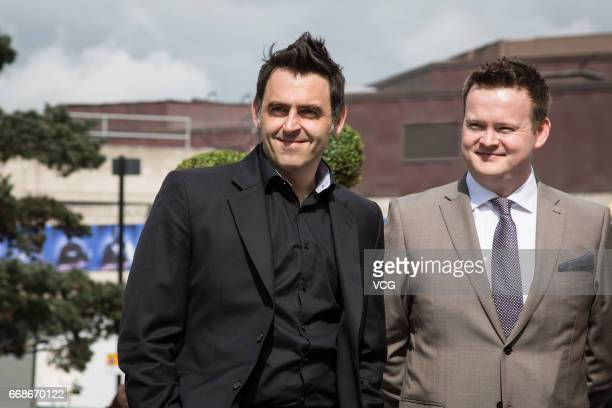Ronnie O'Sullivan of England and Shaun Murphy of England pose for a photo during a media day ahead of the World Snooker Championships at Crucible...