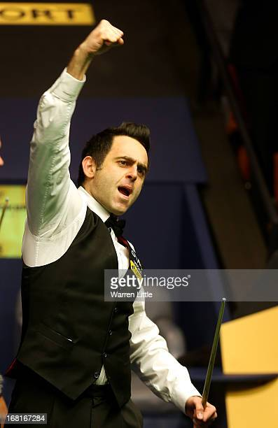 Ronnie O'Sullivan of England celebrates beating Barry Hawkins of England to win the Betfair World Snooker Championship at the Crucible Theatre on May...