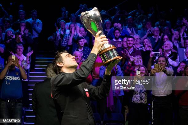 Ronnie O'Sullivan of England celebrates with his trophy after winning the final match against Shaun Murphy of England during the 2017 Betway UK...