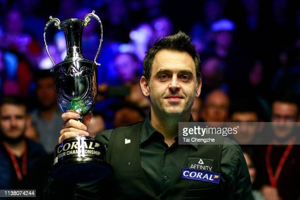 Ronnie O'Sullivan of England celebrates with the trophy after winning the final match against Neil Robertson of Australia on day six of 2019 Coral...