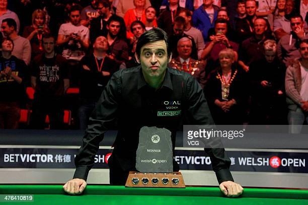 Ronnie O'Sullivan of England celebrates with trophy after winning the final match against Ding Junhui of China in The Welsh Open at the Newport...