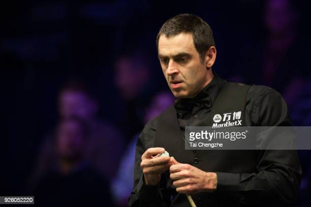 Ronnie O'Sullivan of England chalks the cue during his fourth round match against Mike Dunn of England on day four of 2018 ManBetX Welsh Open at...