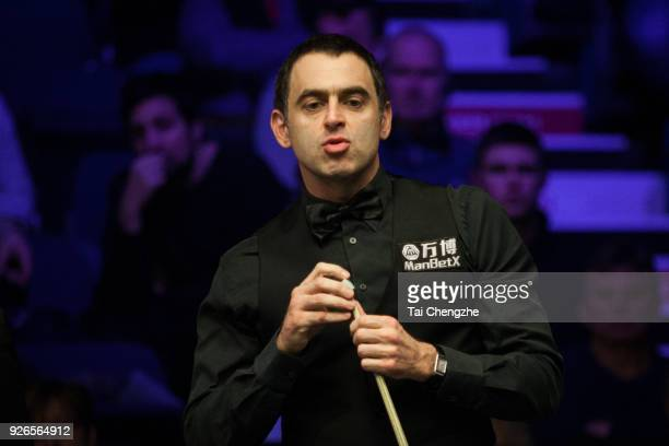 Ronnie O'Sullivan of England chalks the cue during his quarterfinal match against John Higgins of Scotland on day five of 2018 ManBetX Welsh Open at...