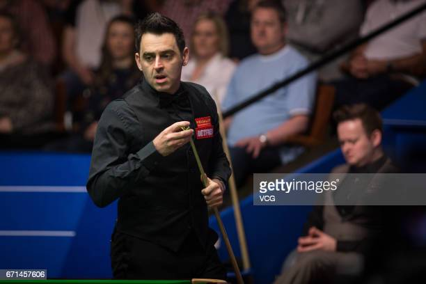 Ronnie O'Sullivan of England chalks the cue during his second round match against Shaun Murphy of England on day eight of Betfred World Championship...