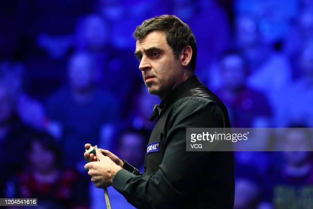 Ronnie O'Sullivan of England chalks the cue during the quarter-final match against Graeme Dott of Scotland on day four of 2020 Coral World Grand Prix...