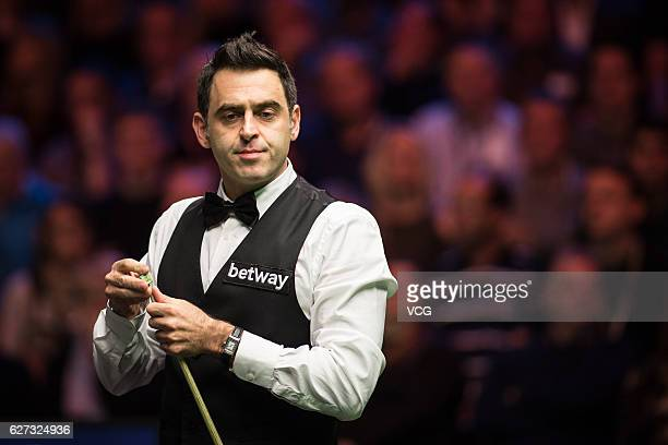 Ronnie O'Sullivan of England chalks the cue during the quarterfinal match against Mark J Williams of Wales on day 11 of Betway UK Championship 2016...