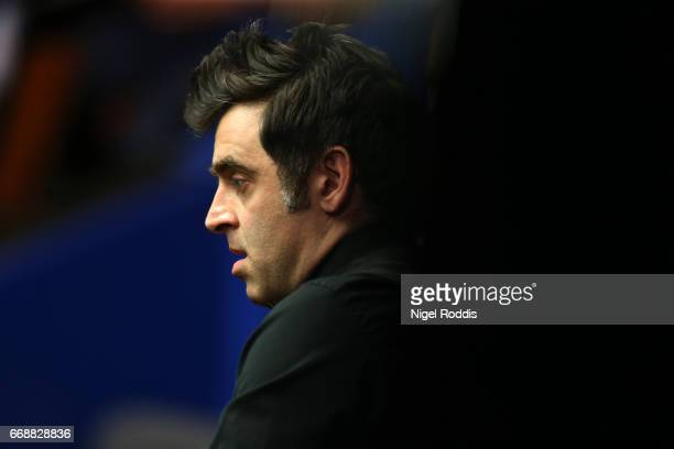 Ronnie O'Sullivan of England during the first round match against Gary Wilson of England on day one of the World Championship Snooker at the Crucible...
