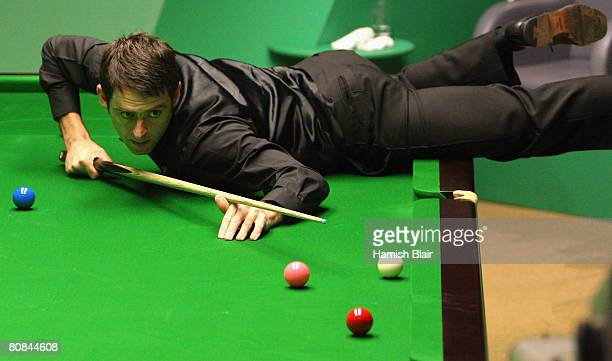 Ronnie O'Sullivan of England fouls by playing a shot without a foot touching the floor in a frame he already had won during his first round match...