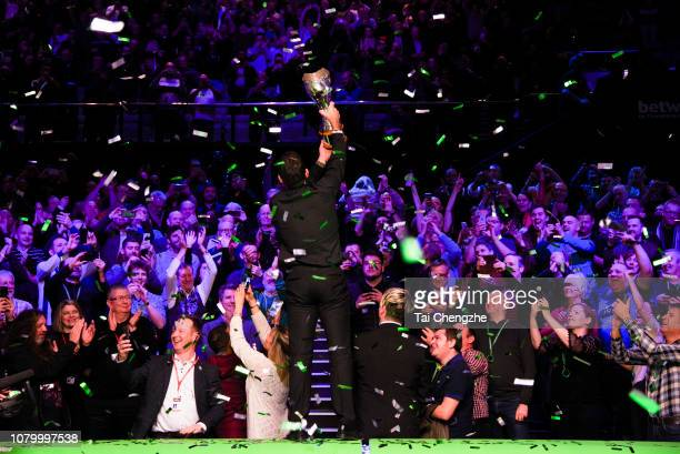 Ronnie O'Sullivan of England holds the trophy after winning the final match against Mark Allen of Northern Ireland on day 13 of 2018 Betway UK...