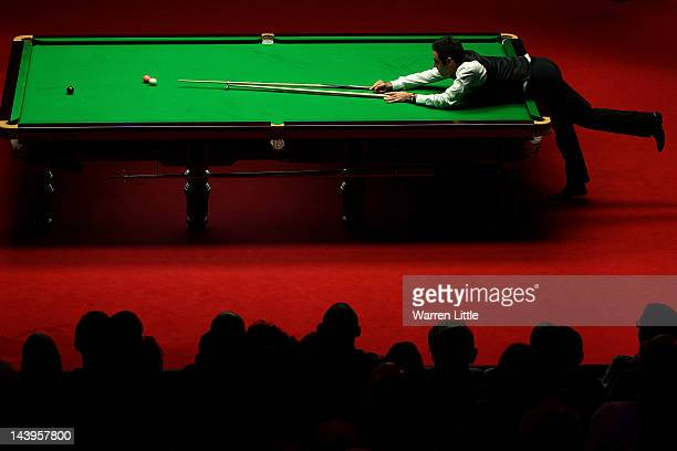 Ronnie O'Sullivan of England in action against Allister Carter of England during the final of the Betfred.com World Snooker Championship at the...