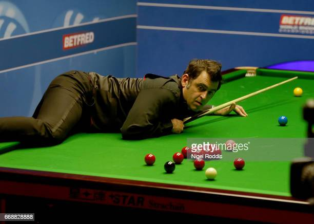 Ronnie O'Sullivan of England in action during his first round match against Gary Wilson of England on day one of the World Championship Snooker at...