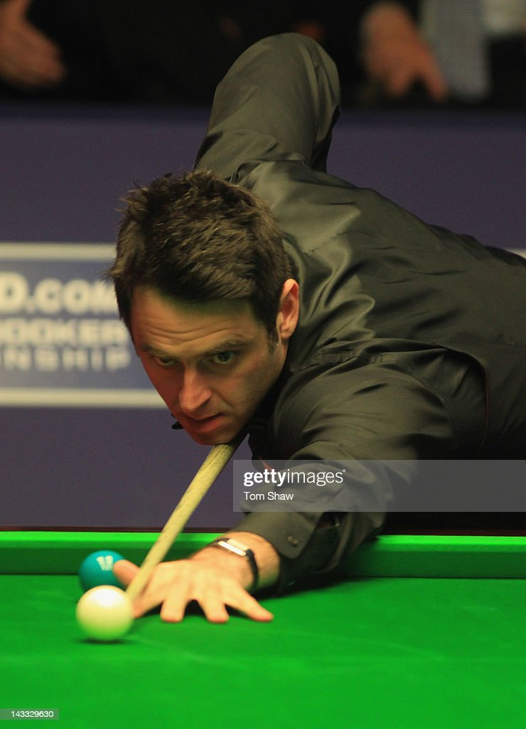 Ronnie O'Sullivan of England in action in his match against Peter Ebdon of England during the first round of the Betfred.com World Snooker Championship at Crucible Theatre on April 24, 2012 in Sheffield, England.