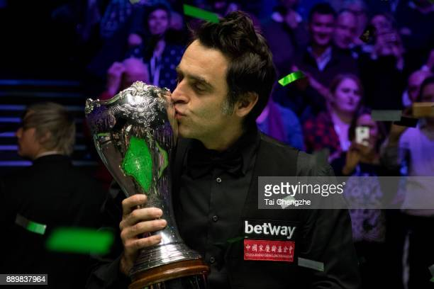 Ronnie O'Sullivan of England kisses his trophy after winning the final match against Shaun Murphy of England during the 2017 Betway UK Championship...