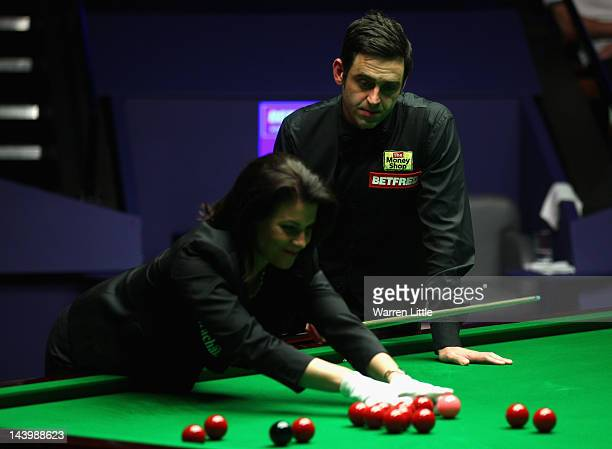 Ronnie O'Sullivan of England looks on as referee Michaela Tabb replaces a ball during the final against Allister Carter of England of the Betfredcom...