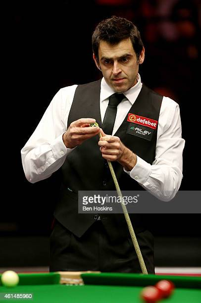 Ronnie O'Sullivan of England looks on during his first round match against Ricky Walden of England on day three of The Dafabet Masters at Alexandra...