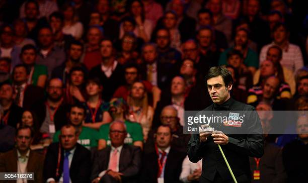 Ronnie O'Sullivan of England looks on during the Final match against Barry Hawkins of England during Day Eight of The Dafabet Masters at Alexandra...